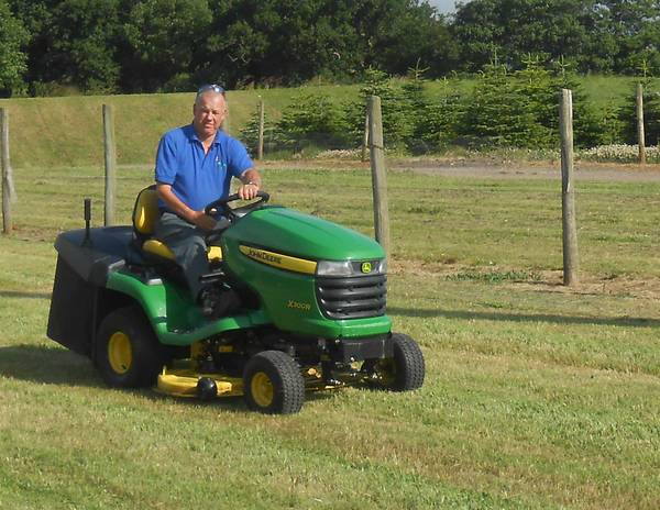 Nigel mowing lawn with ride on mower