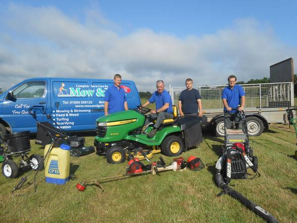 The team with lawn mowing equipment